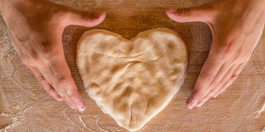 Baker shaping heart shaped dough