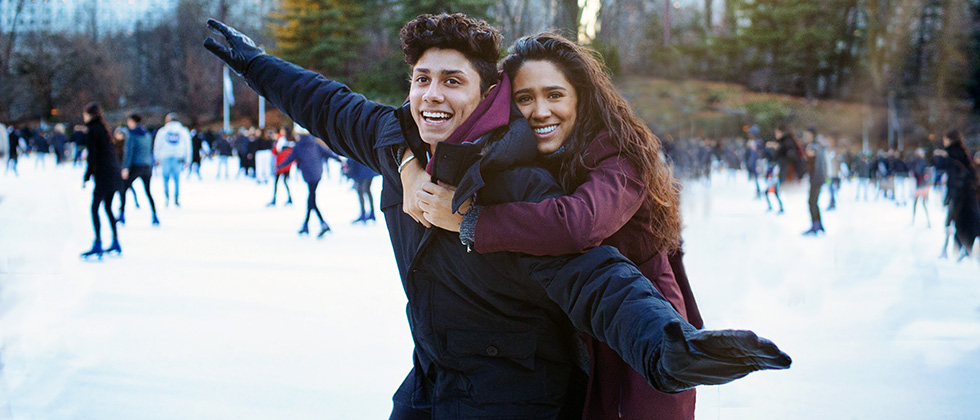 A young couple ice-skating on a first datea as example for first date ideas