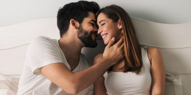 Man kissing woman with face in hand as symobl for how to kiss
