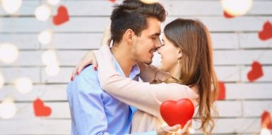 Laws of attraction - man and woman embrace intimately